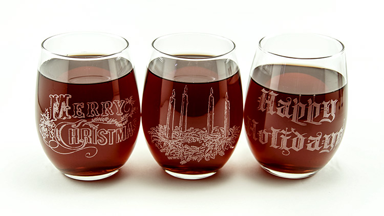 Laser etched stemless wine glasses.