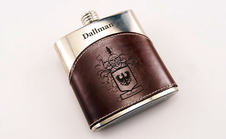A chrome and leather flask engraved with both a CO2 and fiber laser in one Epilog dual source laser machine