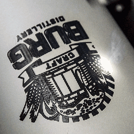 Close-up of a Stainless Steel Growler Being Engraved with an Epilog Laser Using Laser Marking Spray
