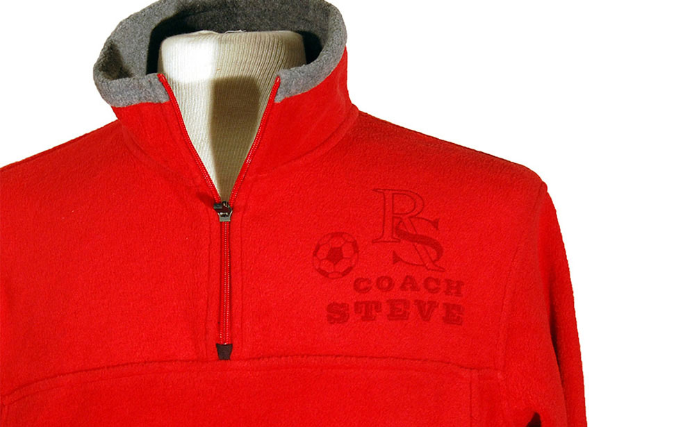 Front of a laser engraved fleece pullover