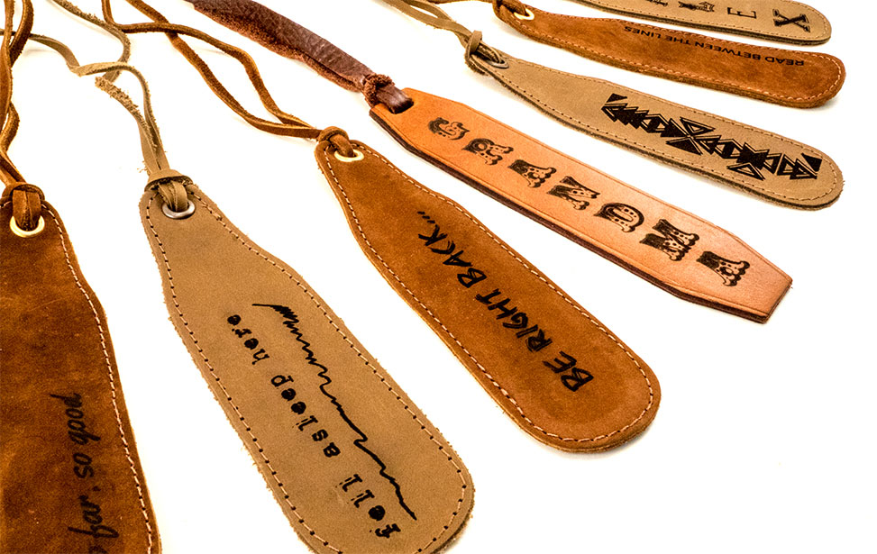 An assortment of leather bookmarks engraved with a laser