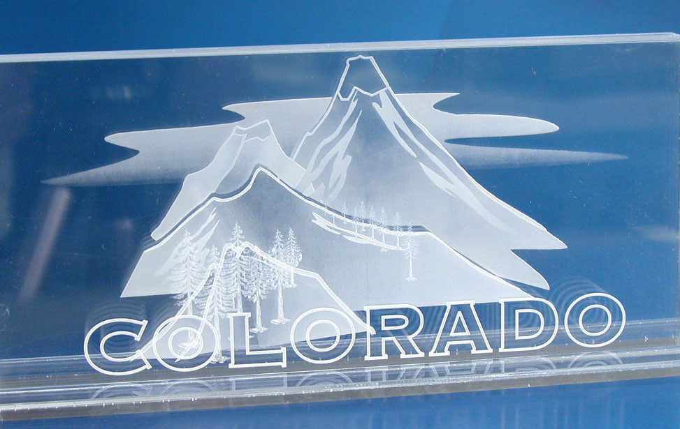 Laser engraved mountains on layers of acrylic to create a 3D appearance