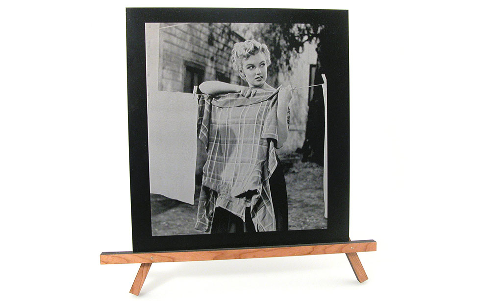 Laser Engraved Photo of a Woman Hanging Laundry