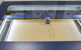 Laser cutting the mdf pieces.