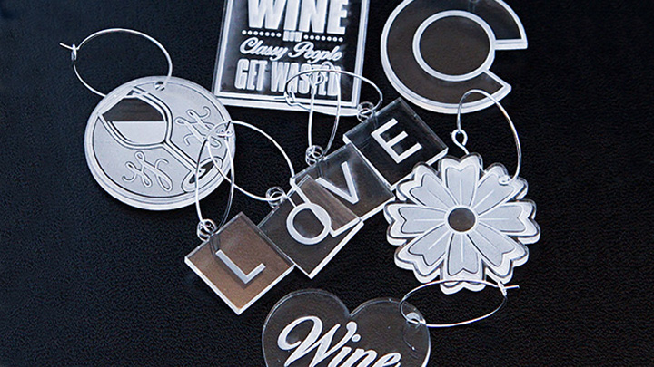 Acrylic wine charms created with a laser.