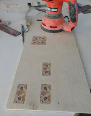 Sanding the inlay