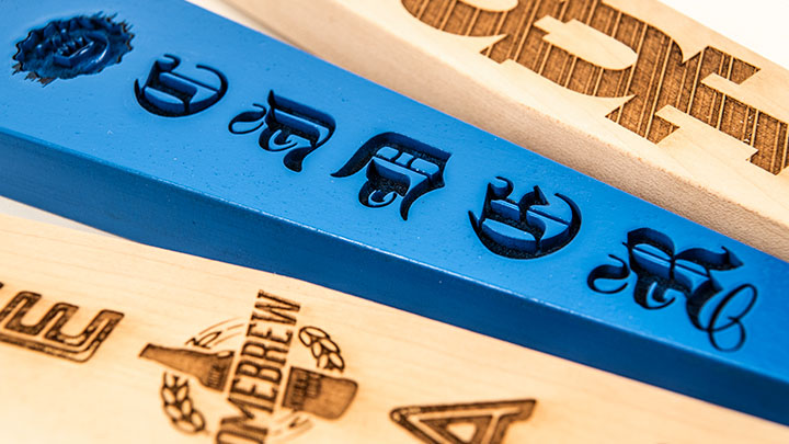close-up of laser engraved beer tap handles