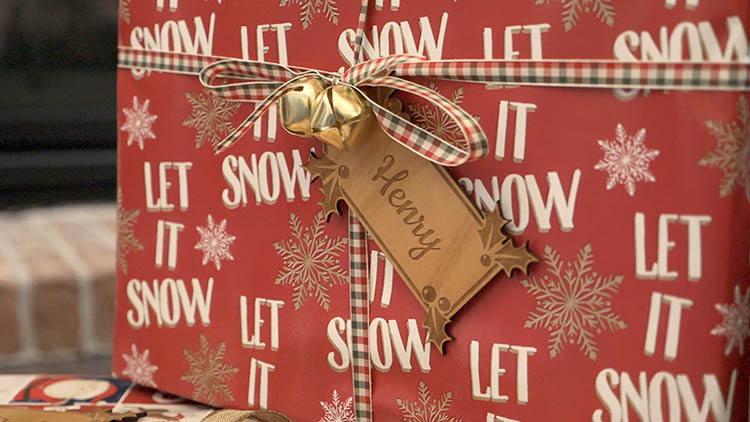 Laser cut gift tag tied to a present