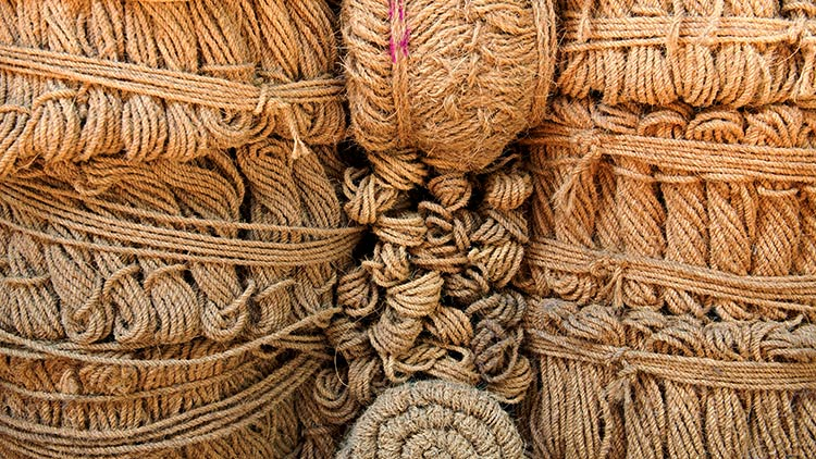 coir rope bundles stacked organized