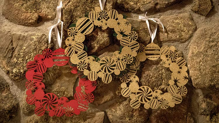 Group of laser engraved holiday wreaths.
