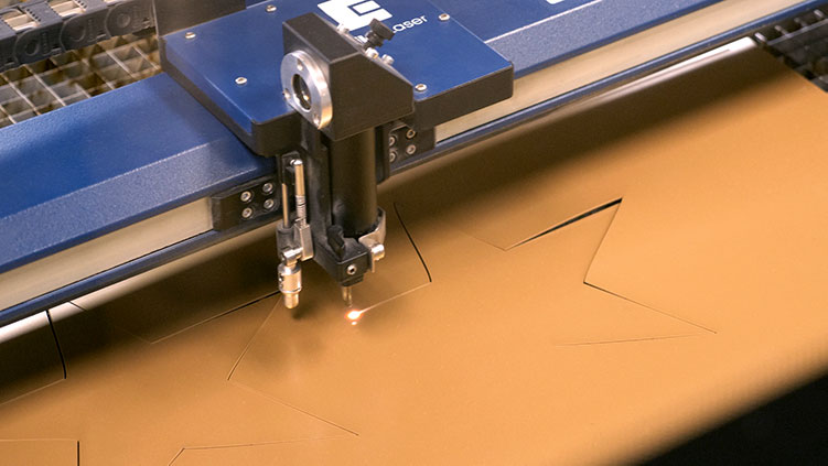 Laser cutting thin plastic into gold stars